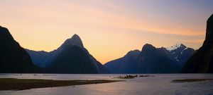 Milford Sound - with landmark Mitre Peak and surrounding mountains just after sunset. Milford Sound is one of the, if not THE, most famous attraction in New Zealand. Many scenes for the 'Lord of the Rings' Triology was filmed in this breathta