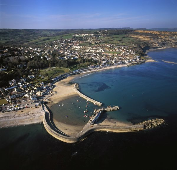 Lyme Regis, showing The Cobb, the harbour wall, coastal town, Lyme Bay, Dorset Date