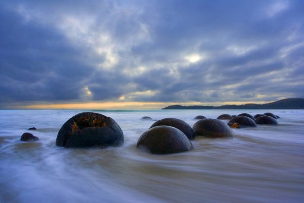 SAS-674 Moeraki Boulders - massive spherical rocks at dawn surrounded by water of incoming tide Coastal Otago, South Island, New Zealand Steffen & Alexandra Sailer Please note that prints are for personal display purposes only