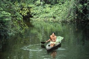 BRAZIL - Caboelo native in canoe, collecting big-headed