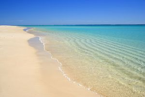 Dream Beach - white sandy beach, clear turquoise coloured water and a deep blue sky