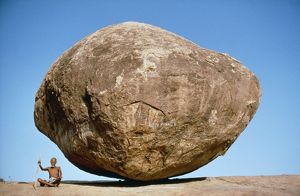 India - Holy man & large boulder