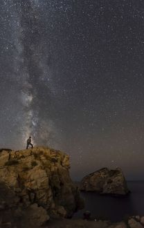 Milky Way with man standing on the edge