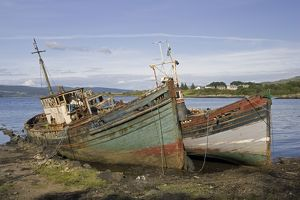 Old fishing boats rotting on beach, Isle of Mull, Scotland, UK
