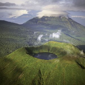 Rwanda - Aerial view of Africa, Mount Visoke with mount Mikono in background