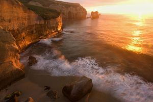 Seascape - view down the rugged coastline at Tunnel Beach with sea stacks and rock