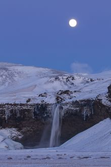 Seljalandfoss Waterfall (66m high) in winter