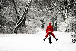 SG-20285-M Father Christmas - in snow - on bicycle freewheeling