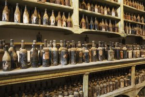 Showroom with old dust covered sherry bottles at the B