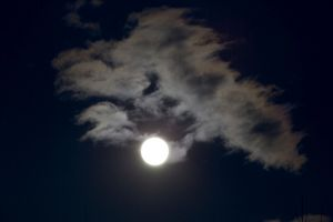 Siilhouette of clouds at night - backlit by new, full moon