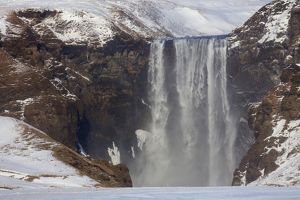Skogafoss Waterfall (63m high) in winter