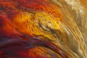Detail of a waterfall in the Rio Tinto Red river wit